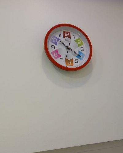 Round shaped wall clock for kids room